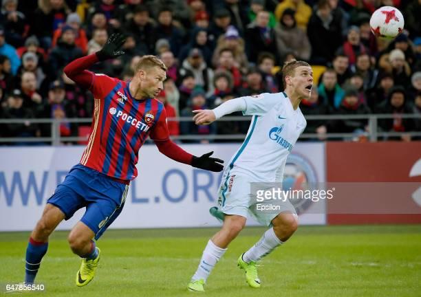 Aleksei Berezutski of PFC CSKA Moscow challenged by Aleksandr Kokorin of FC Zenit Saint Petersburg during the Russian Premier League match between...