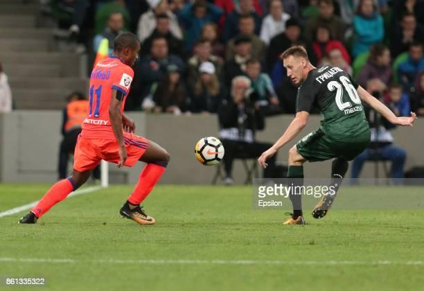 Aleksei Gritsayenko of FC Krasnodar is challenged by Vitinho of FC CSKA Moscow during the Russian Premier League match between FC Krasnodar v FC CSKA...