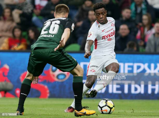 Aleksei Gritsayenko of FC Krasnodar vies for the ball with Quincy Promes of FC Spartak Moscow during the Russian Premier League match between FC...