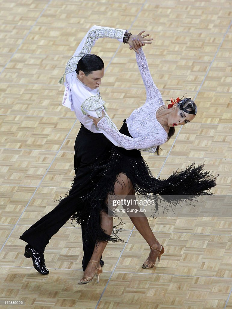 Aleksei Kibkalo and partner Tatiana Kogadei of Kazakhstan compete in the Dancesport- Latin Paso Doble Final at Samsan World Gymnasium during day seven of the 4th Asian Indoor & Martial Arts Games on July 5, 2013 in Incheon, South Korea.