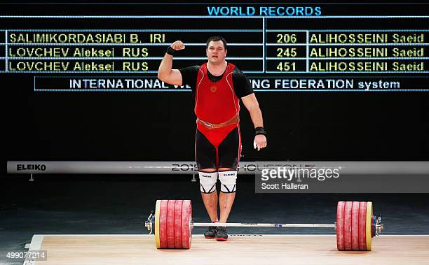 Aleksei Lovchev of Russia celebrates after setting world records in both the clean and jerk and total score in the men's 105kg weight class during...