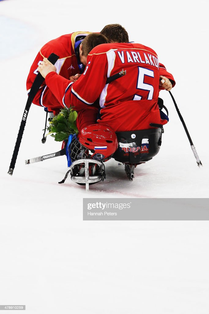 Aleksei Lysov of Russia and Vasilii Varlakov of Russia embrace after losing the ice sledge hockey gold medal game between the Russian Federation and the United States of America at the Shayba Arena during day eight of the 2014 Paralympic Winter Games on March 15, 2014 in Sochi, Russia.