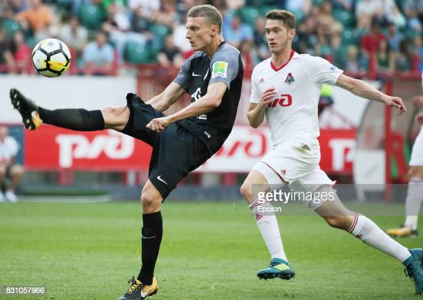 Aleksei Miranchuk of FC Lokomotiv Moscow vies for the ball with Vitali Shakhov of FC Tosno Khabarovsk during the Russian Premier League match between...