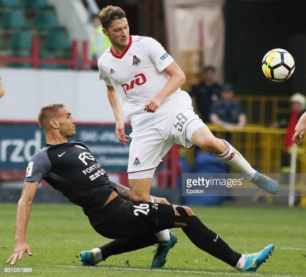 Aleksei Miranchuk of FC Lokomotiv Moscow vies for the ball with Rade Dugalich of FC Tosno Khabarovsk during the Russian Premier League match between...