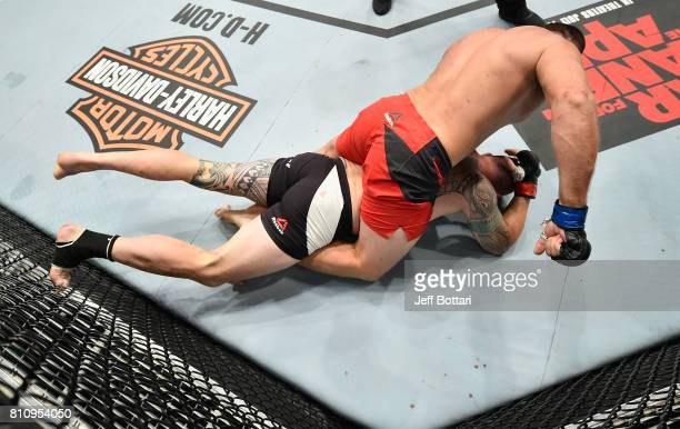 Aleksei Oleinik of Russia punches Travis Browne in their heavyweight bout during the UFC 213 event at TMobile Arena on July 8 2017 in Las Vegas Nevada