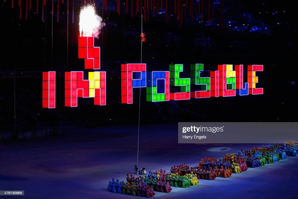 Aleksey Chuvashev, a rowing Paralympian, climbs a rope using just his hands to set off fireworks during the Closing Ceremony of the 2014 Paralympic Winter Games at Fisht Olympic Stadium on March 16, 2014 in Sochi, Russia.