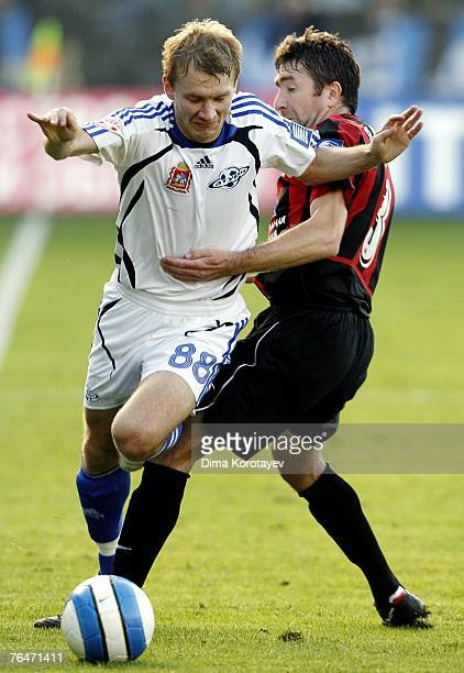 Aleksey Ivanov of FC Saturn Moscow Oblast competes for the ball with Yuri Drozdov of FC Khimki during the Russian Football League Russian Premier...