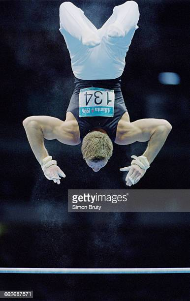 Aleksey Nemov of Russia performs his routine during the Men's Horizontal Bar event of the XXVI Summer Olympic Games on 29 July 1996 at the Georgia...