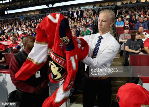 Aleksi Heponiemi puts on his jersey after being selected 40th overall by the Florida Panthers during the 2017 NHL Draft at United Center on June 24...