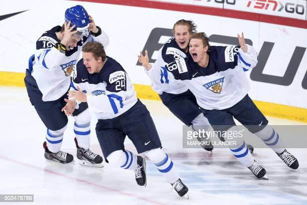 CORRECTION Aleksi Saarela Kasperi Kapanen and Vili Saarijärvi of Finland celebrate the world championship at the of the 2016 IIHF World Junior Ice...
