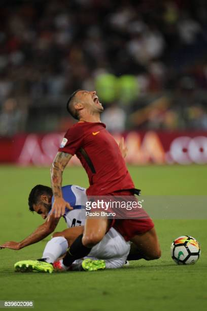 Alekxandar Kolarov of AS Roma competes for the ball with Antonio Candreva of FC Internazionale during the Serie A match between AS Roma and FC...