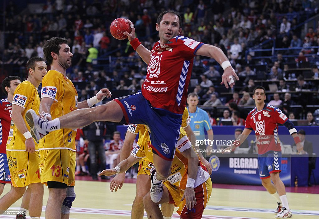 Alem Toskic (R) of Serbia jumps to score past Filip Mirkulovski of Macedonia during the Men's European Handball Championship 2012 second round group one, match between Serbia v Macedonia at Arena Hall on January 25, 2012 in Belgrade, Serbia.