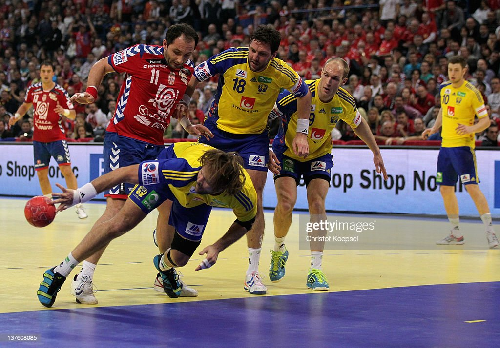 Alem Toskic of Serbia, Magnus Jernemyr, Tobias Karlsson and Johan Jakobsson of Sweden fight for the ball during the Men's European Handball Championship second round group one match between Serbia and Sweden at Beogradska Arena on January 23, 2012 in Belgrade, Serbia.