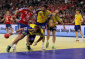 Alem Toskic of Serbia Magnus Jernemyr Tobias Karlsson and Johan Jakobsson of Sweden fight for the ball during the Men's European Handball...