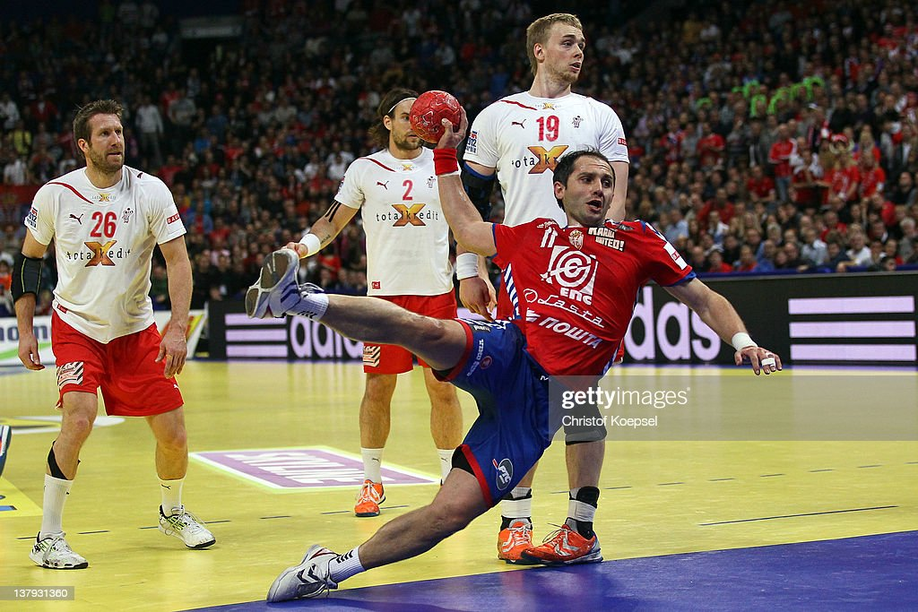 Alem Toskic of Serbia (R) scores a goal during the Men's European Handball Championship final match between Serbia and Denmark at Beogradska Arena on January 29, 2012 in Belgrade, Serbia.