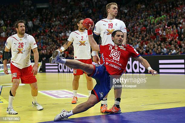 Alem Toskic of Serbia scores a goal during the Men's European Handball Championship final match between Serbia and Denmark at Beogradska Arena on...