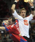 Alem Toskic of Serbia vies with Oliver Roggisch of Germany during their World Handball Championship match in Zadar on January 24 2009 AFP...
