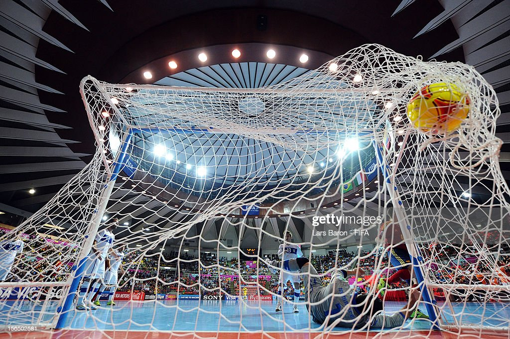 Alemao of Spain scores his teams second goal during the FIFA Futsal World Cup SemiFinal match between Italy and Spain at Indoor Stadium Huamark on...