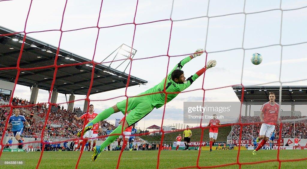 Alen Halilovic (L) of Hamburg scores the opening goal against goalie Johannes Brinkies of Zwickau during the DFB Cup match between FSV Zwickau and Hamburger SV at Stadion Zwickau on August 22, 2016 in Zwickau, Germany.