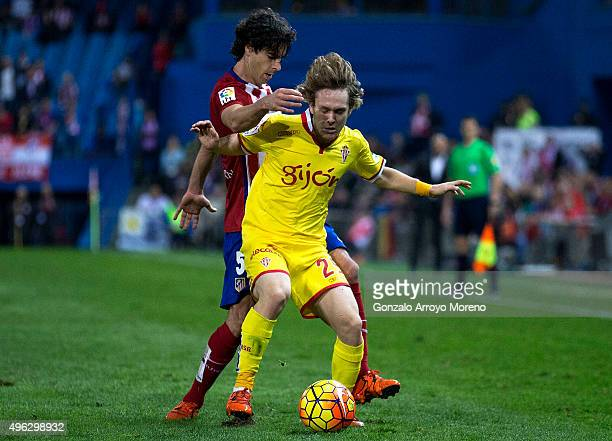 Alen Halilovic of Real Sporting de Gijon competes for the ball with Tiago Mendes of Atletico de Madrid during the La Liga mathc bewteen Club Atletico...
