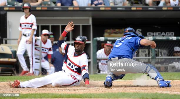 Alen Hanson of the Chicago White slides home safely against the Kansas City Royals on August 13 2017 at Guaranteed Rate Field in Chicago Illinois The...