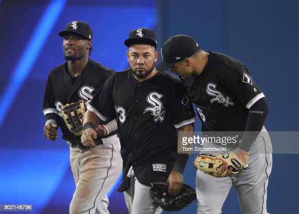Alen Hanson of the Chicago White Sox celebrates their victory with Melky Cabrera and Avisail Garcia during MLB game action against the Toronto Blue...