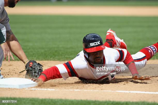 Alen Hanson of the Chicago White Sox dives safely back to first base in the 6th ining against the Oakland Athletics at Guaranteed Rate Field on June...
