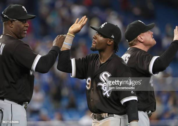 Alen Hanson of the Chicago White Sox is congratulated by first base coach Daryl Boston after their victory during MLB game action against the Toronto...