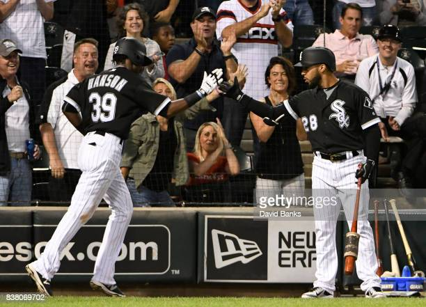 Alen Hanson of the Chicago White Sox is greeted by Leury Garcia after scoring against the Minnesota Twins during the third inning on August 23 2017...