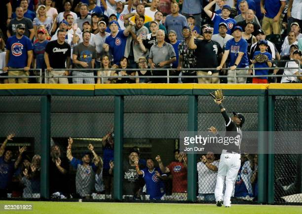 Alen Hanson of the Chicago White Sox makes a catch for an out on a ball hit by Addison Russell of the Chicago Cubs to end the fourth inning at...