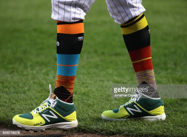 Alen Hanson of the Chicago White Sox models the special socks being worn by MLB Players on 'Players Weekend' during a game against the Detroit Tigers...