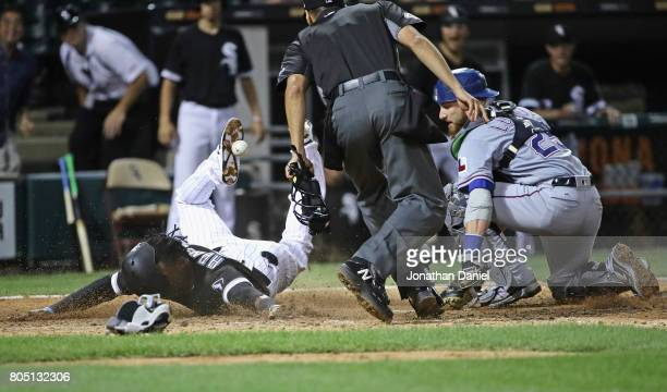 Alen Hanson of the Chicago White Sox scores the game winning run after Jonathan Lucroy of the Texas Rangers drops thye relay throw in the 9th inning...
