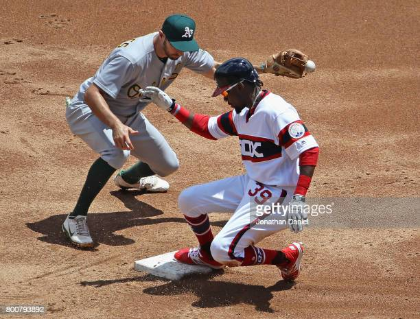 Alen Hanson of the Chicago White Sox slides safely into second base in the 1st inning as Adam Rosales of the Oakland Athletics takes the throw at...