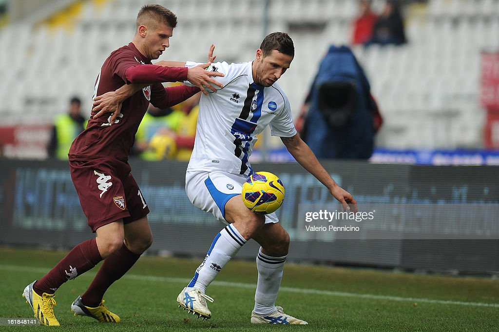 Alen Stevanovic (L) of Torino FC competes with Riccardo Cazzola of Atalanta BC during the Serie A match between Torino FC and Atalanta BC at Stadio Olimpico di Torino on February 17, 2013 in Turin, Italy.