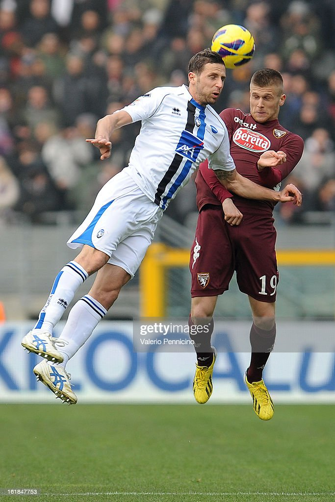Alen Stevanovic (R) of Torino FC goes up with Riccardo Cazzola of Atalanta BC during the Serie A match between Torino FC and Atalanta BC at Stadio Olimpico di Torino on February 17, 2013 in Turin, Italy.
