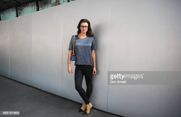 Alena Berticevski wears J Brand pants Chanel boots Chanel boy bag and Tsubi glasses at MercedesBenz Fashion Week Australia 2014 at Carriageworks on...