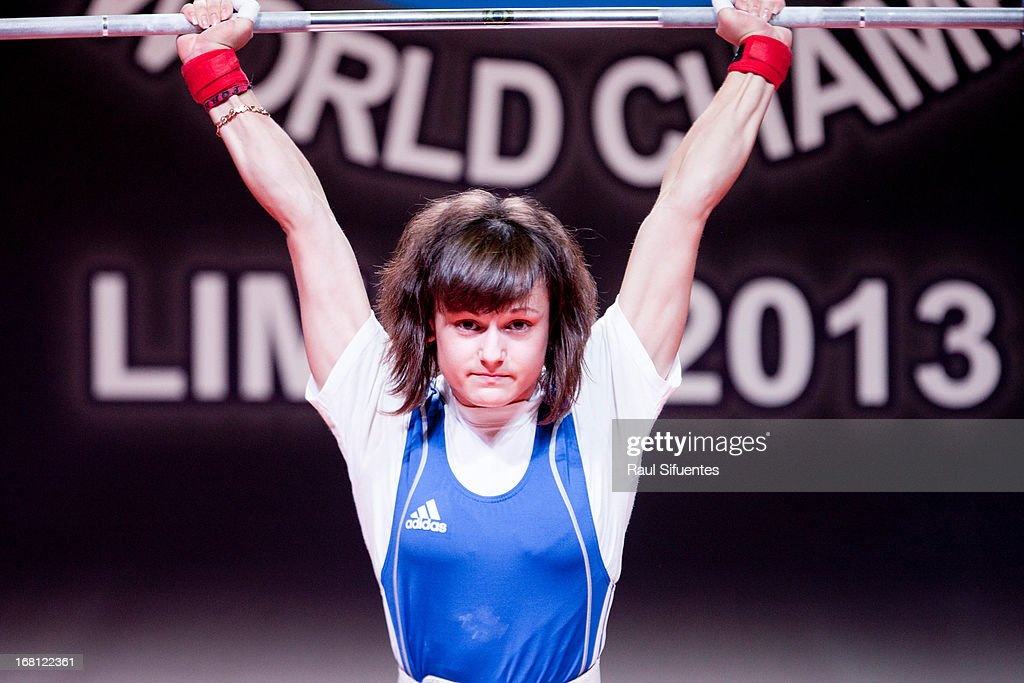 Alena Chychkan of Belarus A competes in the Women's 53kg clean and jerk during day two of the 2013 Junior Weightlifting World Championship at Maria Angola Convention Center on April 05, 2013 in Lima, Peru.