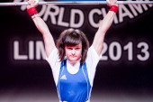 Alena Chychkan of Belarus A competes in the Women's 53kg clean and jerk during day two of the 2013 Junior Weightlifting World Championship at Maria...