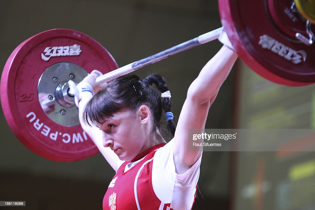 Alena Chychkan of Belarus A competes in the Women's 53kg snatch during day two of the 2013 Junior Weightlifting World Championship at Maria Angola Convention Center on April 05, 2013 in Lima, Peru.