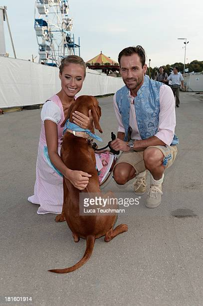 Alena Gerber and Sven Hannawald attend the 'Almauftrieb' as part of the Oktoberfest beer festival at Kaefer tent at Theresienwiese on September 22...
