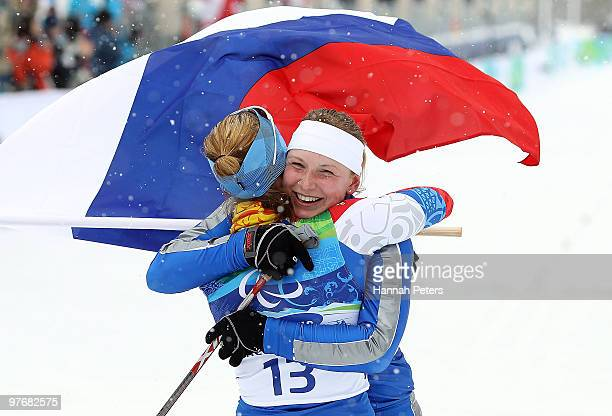 Alena Gorbunova of Russia celebrates winning the bronze medal with gold medalist Anna Burmistrova of Russia during the Women's 3km Pursuit Standing...