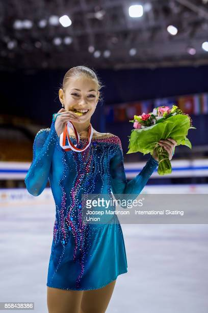 Alena Kostorinaia of Russia poses in the Ladies medal ceremony during day two of the ISU Junior Grand Prix of Figure Skating at Olivia Ice Rink on...