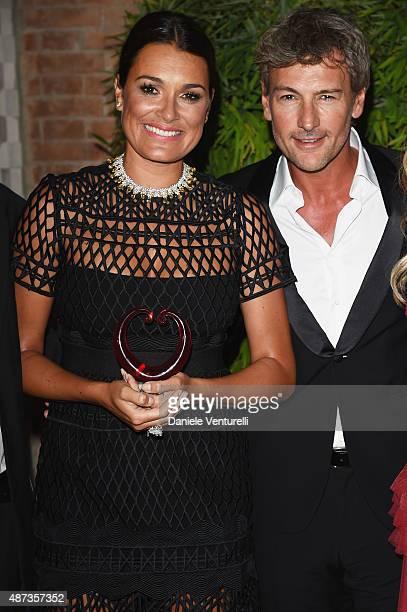 Alena Seredova and Roberto Farnesi attend a party for 'DivaDonna' 10th Anniversary Party during the 72nd Venice Film Festival at Palazzo del Casino...