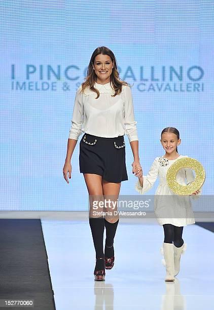 Alena Seredova walks the runway of I Pinco Pallino Fashion Show as part of Fashion Kids For Children In Crisis Onlus Fashion Show held at Castello...