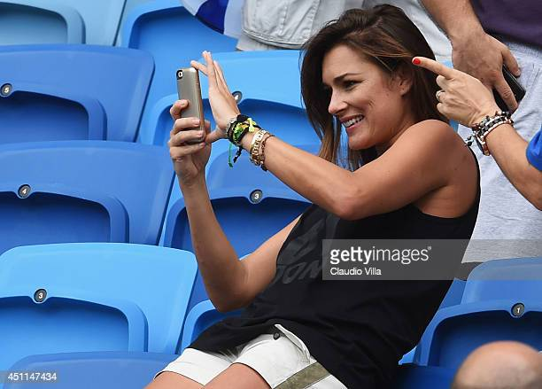 Alena Seredova wife of Gianluigi Buffon of Italy take a photograph ahead of the 2014 FIFA World Cup Brazil Group D match between Italy and Uruguay at...