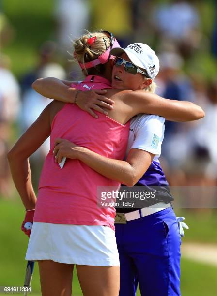 Alena Sharp of Canada hugs Lexi Thompson of the USA following their third round of the Manulife LPGA Classic at Whistle Bear Golf Club on June 10...