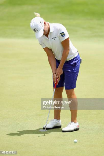 Alena Sharp of Canada putts on the 18th green during the second round of the LPGA LOTTE Championship Presented By Hershey at Ko Olina Golf Club on...