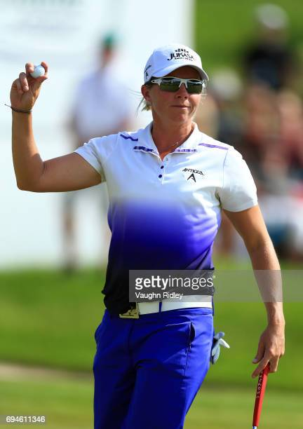 Alena Sharp of Canada reacts after sinking her putt on the 18th green during the third round of the Manulife LPGA Classic at Whistle Bear Golf Club...