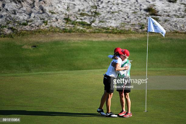 Alena Sharp of Canada reacts on the 18th green during the First Round of Women's Golf at Olympic Golf Course on Day 12 of the Rio 2016 Olympic Games...