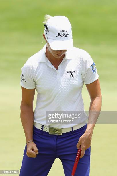 Alena Sharp of Canada reacts to a putt on the 18th green during the second round of the LPGA LOTTE Championship Presented By Hershey at Ko Olina Golf...
